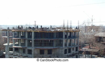 Time lapse during the construction of two floors in the...