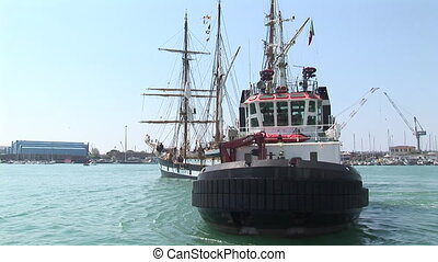 Tugboat and sailing vessel - Tugboat towing the barkentine...