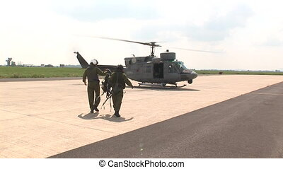 Soldiers boarding a helicopter - Soldiers boarding a...