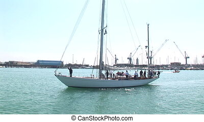 Large sail boat with tourists on board at a port in Italy