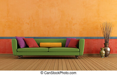 Green red and orange living room - Green sofa in a colorful...