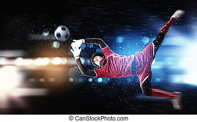Goalkeeper catches the ball . At the stadium, in the...