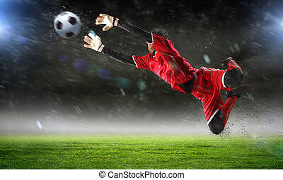 Goalkeeper catches the ball At the stadium, in the spotlight...