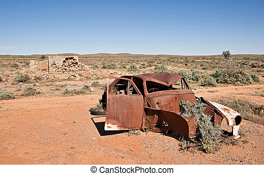 old car in the desert - great image of an old car rusting...