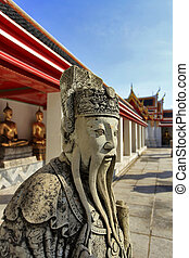 Chinese stone guardian statue in Wat Pho Buddhist Temple , Bangkok, Thailand