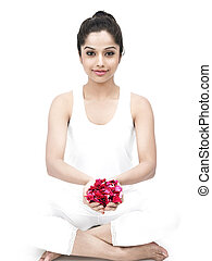 pretty woman with rose petals - woman meditating with rose...