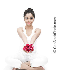 pretty woman with rose petals