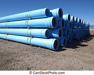 Water Pipe - A stack of water pipe at a construction site.