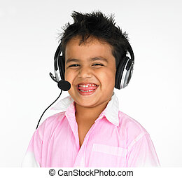 asian boy with headphones an adorable asian boy of indian...