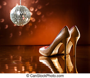 Beautiful brown stilettos on the dance floor with mirror...