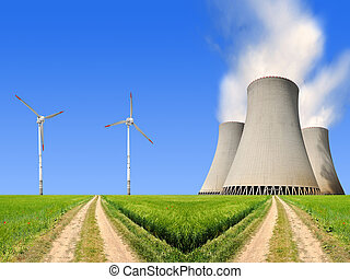 energy concept - field way with nuclear power plant and wind...
