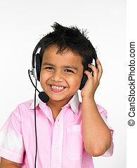 enjoying music with his headphones - asian boy with...