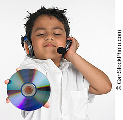 boy listening to music - an excited Asian boy of indian...