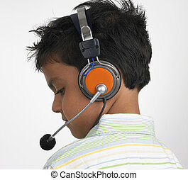 profile of Asian boy with headset - back profile of an Asian...