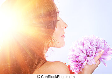 woman with big flower - beautiful woman with big flower in...