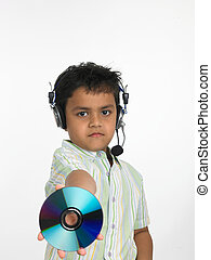 asian boy with compact disc - an excited Asian boy of indian...