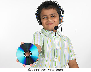 kid listening to music - an excited Asian boy of indian...