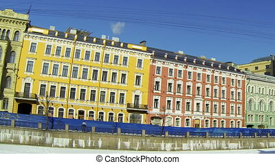 Facade of an old building in St. Petersburg. Embankment of...
