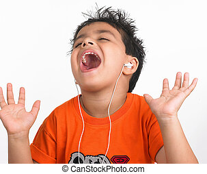 asian kid listening to music - a handsome Asian boy of...