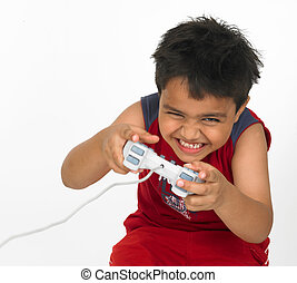 boy playing on his play station - Asian boy playing on his...