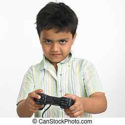 boy playing with his play station - Asian boy playing with...