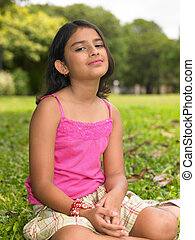 girl sitting in the park