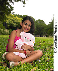 girl in the garden - Asian girl in the garden with her pink...