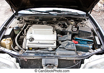 Dirty engine under bonnet of car
