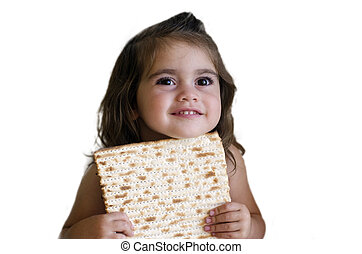 Passover Jewish Holiday - Jewish girl eating a matzo in...