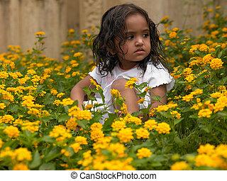 Asian girl among flowering plants