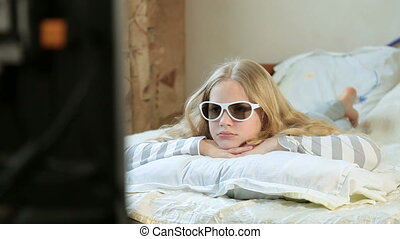 Little Girl Watching 3D TV at Home
