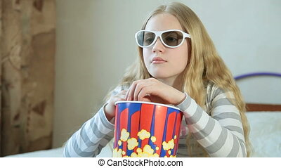 Little Girl Watching 3D TV at Home - Little blonde girl...