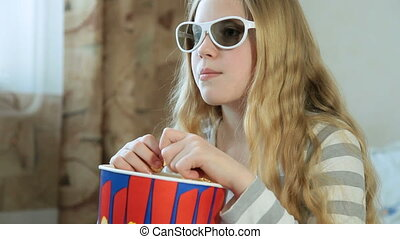 Child Watching 3D TV Movie at Home - Little blonde girl...