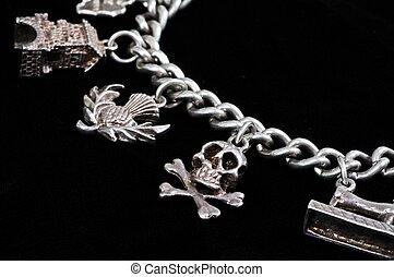 Silver charm on chain. - Sterling silver charm bracelet...