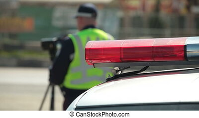 Police Officer Using Radar Speed Gun