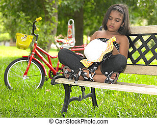 kid in a park sitting on a bench
