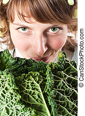 woman and fresh savoy cabbage - closeup of young beautiful...