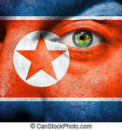 Flag painted on face  to show North Korea support