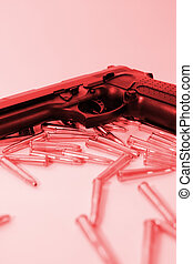 gun crime - ammo and a handgun on a red background depicting...