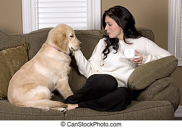 woman and dog - pretty brunette playing with her dog in...
