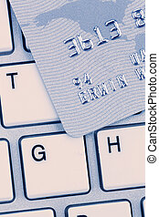 credit card and keyboard - closeup of a credit card for...