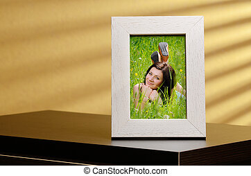 Photo frame - Girls portrait in a photo frame, standing on a...