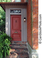 Inviting Door - An attractive red entry to an old brick...