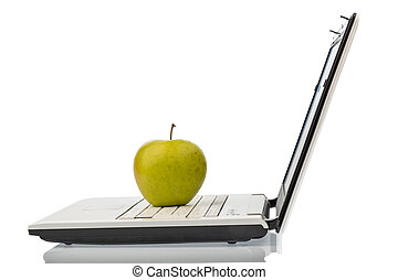 apple lies on a keyboard - an apple is on a computer...