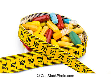 tablets and measuring tape, symbol photo for appetite...