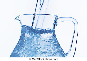 pitcher of water - pour water in a carafe, symbol photo for...