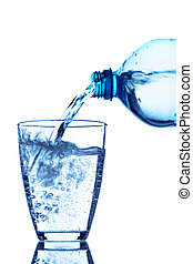 pour water into a glass - from a water bottle of water being...