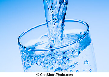 pour water into a glass, symbolic photo for drinking water,...