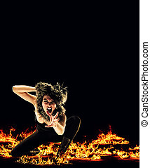 Woman surrounded by fire - Vampire like woman surrounded by...