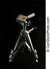Miniature Tripod Against Black - Small or miniature still...